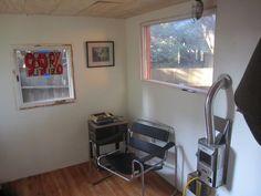matt wolpe tiny house on a trailer living area and fireplace   DIY Tiny House on a Trailer for $5,500