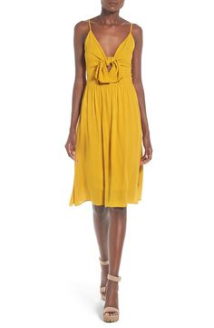 Free shipping and returns on Leith Tie Front Dress at Nordstrom.com. An airy chiffon dress with slender straps is styled with a flouncy front tie and breezy skirt that gracefully falls away from your frame.