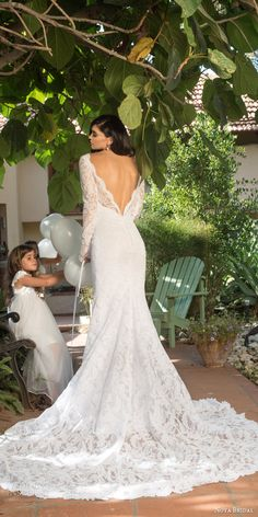 noya bridal riki dalal 2015 style 1113 illusion long sleeve wedding dress sheath silhouette low back view train