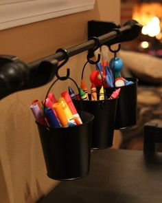 art supplies hanging on a mounted curtain rod (or even towel rack) in small buckets above a kids craft table. Organisation Hacks, Kids Room Organization, Playroom Ideas, Art Supplies Storage, Craft Supplies, Desk Supplies, Classroom Supplies, School Supplies, Office Supplies