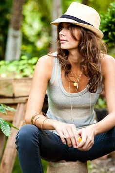 Gray tank, nice jeans, good necklace. Love the hat.