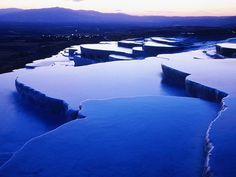 Pamukkale, Turkey - The translation of Pumakkale is cotton castle. The great attraction is the white immensity of the cliff with sculptured basins full of water and congealed waterfalls, they seem formed by white cotton. (outstandingplaces.com)