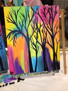 Rainbow background with tree silhouettes. Easy-Acrylic-Canvas-Painting-Ideas-for-Beginners