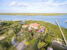 Riverfront Estate 3 acres, gated, dock, garage Apt, Bahamian style main residence with stunning hardwood floors, gourmet kitchen. Presented by Joyce Marsh, Premier Sotheby's International Realty. Offered at 1.85M