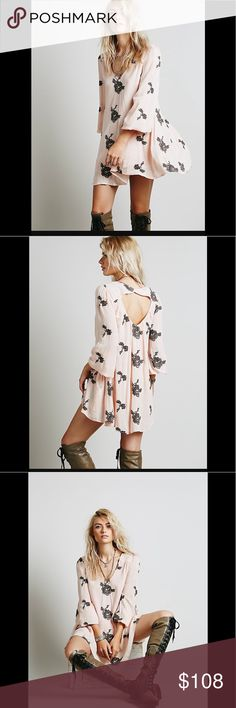"""Free People Embroidered Austin Dress in Soft Pink Flowy swing dress with beautiful floral embroidered design. Elastic band at bust and cuffs. Deep """"V"""" in back. Lined. Size XS. This color is sold out on FP and my favorite of them all! What's better? I also have the boots shown on the model for sale, Jeffrey Campbell Knee High Lace Boots. Get the whole outfit! Free People Dresses Mini"""