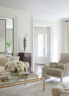 Tailored upholstery dresses up this simple white room for a sophisticated feel.