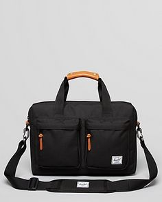 """Herschel Supply Co. Totem Brief - Canvas/leather/nylon. Imported. Detachable adjustable shoulder strap, reinforced drop handles. Double front zip pockets with leather pull tabs, logo on front. Spacious interior, stripe lining, headphone hole at top of bag. 12"""" x 18"""" x 5"""""""