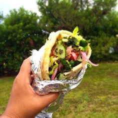 """@tribe_rd_kitchen has some of the best weekly specials. Take for example this """"Hercules"""". Huge tender chunks of lemon oregano chicken all things that make a Greek salad a touch of hummus and some tzatziki sauce to seal the deal in a pita wrap. We wonder what they'll be serving up this week... #biteofbermuda #bermuda #bermudafood #wearebda #wearebermuda #wrap #greekfood #pita #sharemybermuda #lovemybermuda #eeeeeats #forkyeah"""