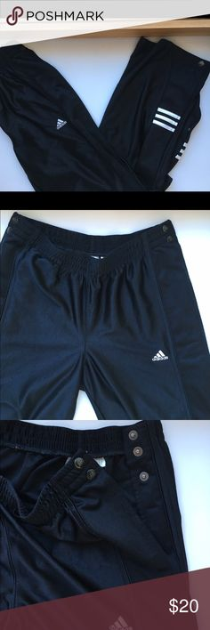 Men's black Adidas athletic button down pants Men's black Adidas athletic pants. Sides button all the way down from waist to hem. Adidas Pants Sweatpants & Joggers