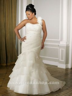 Plus size wedding dress, wedding gown for the full figured or curvy woman. Flattering and slimming soft layers.