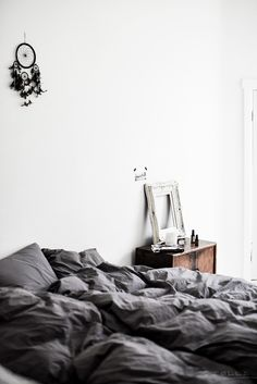 Grey bed linen. Photo by Stella Harasek - Notes on a life.