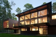 """Residential Architecture: Stoneridge House by In Situ Studio: """"..In Situ Studioprovided a contemporary redesign to an existing house in Chapel Hill, North Carolina, USA..This 1960s-era Deck House built in 1986 is located on a beautiful wooded site in Chapel Hill. We have transformed it to suit the client's needs, while maintaining the integrity of the Deck House. The gable roof portion of the house over the living and dining room has been lifted to the north, creating a two storey wall of…"""