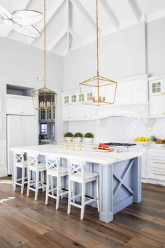White is exceptionally right in an East Coast inspired kitchen. Pair marble benches with sparkling gold accents to enhance the sense of luxury. Hamptons Style Homes, The Hamptons, Kitchen Reno, Kitchen Design, Kitchen Ideas, Hamptons Kitchen, Feature Tiles, Property Design, Country Kitchen