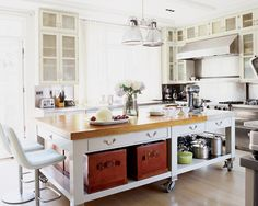 This oversized kitchen island is absolutely amazing and perfect for so much extra storage/  Plus, I love those chairs!