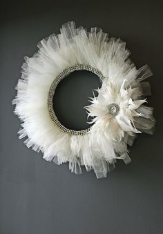 DIY Wreath - Handmade ivory tulle and rhinestones with feather accent.