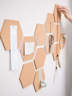 cork hexagons with pastel edges cna be used to create a customized pinboard