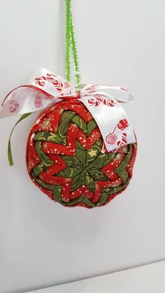 "Quilted 3"" round christmas ornament.                                                                                                                                                                                 More"