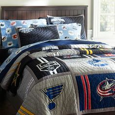 New NHL Western Quilt + Sham-my 2 yr old's new bed set, that he insisted on having!! Too soon?