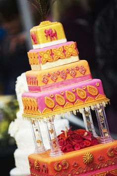 Bright pink and orange exotic wedding cake