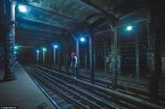 Mr Berg (pictured) goes down onto the tracks of the subway, but makes sure to be careful and avoid touching the third rail, which carries 625 volts of electricity
