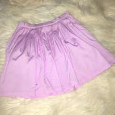 Loose pleated skirt. NWOT Pinkish lavender with side zip closer and inner lining. Aus size 8 , US size 4. NWO. Includes a lining insides. Very pretty and flirty, perfect for summer. Paper heart Skirts