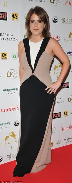 The princess showed off her slimmer waist and toned arms in this form fitting gown at a charity boxing match in London in December