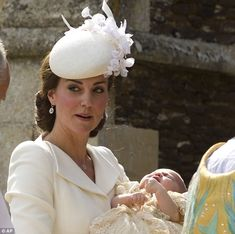 Princess Charlotte appeared to be crying as she was carried into the church for her baptism by her mother, The Duchess of Cambridge