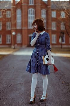 Blue 60s? dress with white collar, white tights.  The clothes horse.