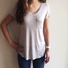 """[grey V-neck short sleeved soft tee] [Please don't purchase this listing as I will make a new one for you]This beautiful GREY top has a V-neckline, breast pocket, and short sleeves. It feels so nice against the skin, and the fabric feels SUPER soft.Reminds me very much of Vince's buttery textured clothes! VERY form fitting and makes your body look amazing. 100% rayon. Size S (modeled)- 25"""" long,17""""laying flat pit to pit.Doesn't come with tags as it was purchased directly from the…"""