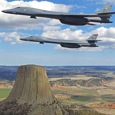 Two B-1 bombers out of Ellsworth AFB, South Dakota flying next the Devils Tower in Wyoming.