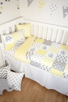 A gorgeous and classic grey and yellow patchwork elephant cot quilt, transitions seamlessly into a modern nursery. Coordinating with the plush, yellow minky is a perfect gender neutral nursery set. - Patchwork cot quilt (100cm x 130cm): Grey and yellow fabric patches with 4 screenprinted grey elephaqnts ** With a 200gsm quilt wadding sewn into this easy care,generous sized quilt, it is warm and soft for your little one.