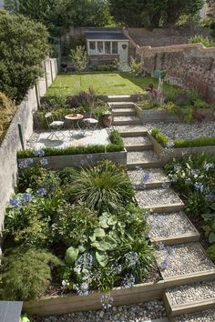 The garden features a carefully chosen colour palette, with a selection of pebbl. The garden features a carefully chosen colour palette, with a selection of pebbles, wood and Indian Small Cottage Garden Ideas, Cottage Garden Design, Backyard Garden Design, Small Garden Design, Terrace Garden, Backyard Cottage, Backyard Ideas, Backyard Patio, Small Garden Slope Ideas