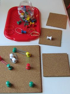 Stretch ways to explore with cork board, giant push pins and rubberbands.
