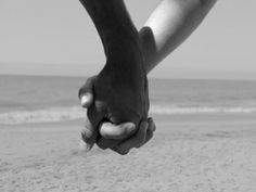 Holding hands with my love as we walk down the beach!