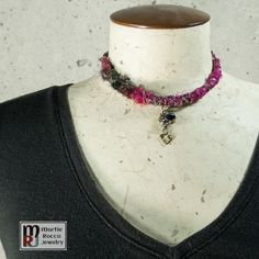 This Boho inspired mixed media design is created with silk sari remnants and yarn wrapped and knotted around a base metal wire. Seed beads were also threaded onto colored wire and messy wrapped around the fabric. Dangling at the center is an iride...