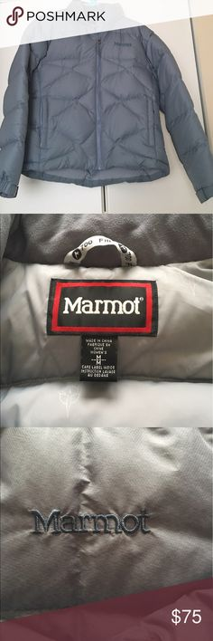 Marmot 700 goose down puffer jacket This light grey jacket is gently used and in excellent condition.  It has two front zipper pockets and one internal zipper pocket.  The jacket also has a nylon hood that folds up into the collar when not needed.  There is Velcro on the sleeves for a custom fit around your gloves to keep out the cold. Marmot Jackets & Coats Puffers