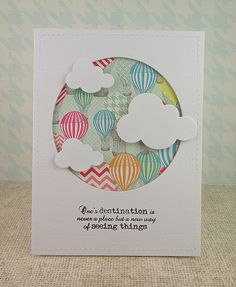 handmade card ... luv how the sentiment is reflected in the card design ... negative space circle backed with patterned paper with hot air balloons ... die cut fluffy clouds appear to be floating in front of them ... fun card!! ...