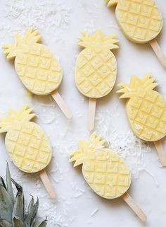 we love pineapples, we love popsicles, lets have a pina colada popcicle.