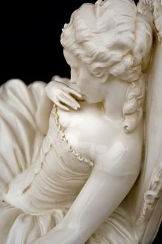 18th century marble - sleeping beauty.  I would love to know who the sculptor was and what he called this work