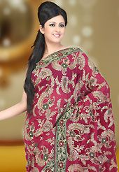 The fascinating beautiful subtly garment with lovely patterns. This magenta faux georgette saree have beautiful embroidery patch work which is embellished with resham, zari, sequins and stone work. This saree gives you a modern and different look in fabulous style. Matching blouse is available. Slight Color variations are possible due to differing screen and photograph resolutions.