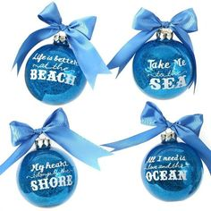 Blue Christmas Ornaments with Beach and Ocean Quotes: http://www.completely-coastal.com/2015/11/sea-inspired-coastal-christmas-collections.html