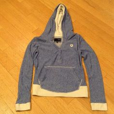 Hurley women's hoodie Size small. Blue and white with off white bottom of top and sleeves. Two snap closure at chest with v-neck. Full front pocket. 80% cotton and 20% polyester. Cozy and in excellent hardly used condition. Feel free to ask me any questions Hurley Tops Sweatshirts & Hoodies