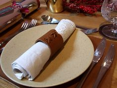 Making simple leather napkin rings for Christmas - this is from the calf leather pieces bag and laced with suede lace..