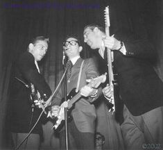Waylon Jennings, Buddy Holly, Carl Bunch, Tommy Allsup.  The Winter Dance Party - January 31, 1959 - Duluth, MN Armory.