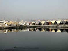 Writer Lisa Kirchner shares her experience at India's Kumbh Mela spiritual festival, the largest gathering in the world. Pictured: A tent city along the Ganges.  http://vivmag.com/lost-and-found-at-indias-enormous-kumbh-mela-spiritual-celebration/#