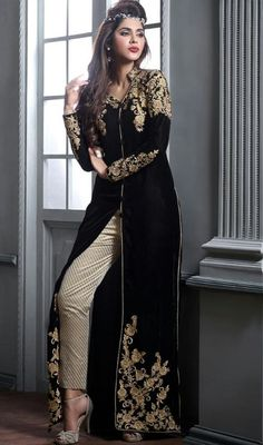Own your style wearing this black color velvet embroidered pant style suit. The ethnic lace and resham work for apparel adds a sign of magnificence statement with your look. #velvetdresses #velvetembroidereddress #longvelvetsuits