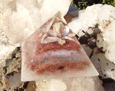 An orgonite pyramid to transmute EMF imbalances and activate your Highest potential through the power of Orgone Alchemy. Orgone pyramids are