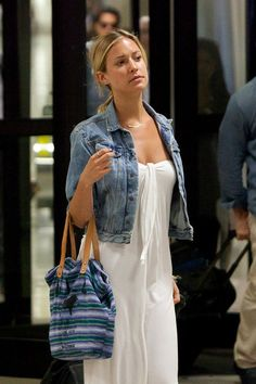 cropped denim jacket over a white maxi dress