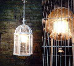 Rough-Luxe, repurposed birdcage light fixture with two vintage glass shades inside: