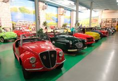 The colorful vehicles arranged in Voit's private museum look almost like candy.